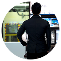 Male standing in front of control systems