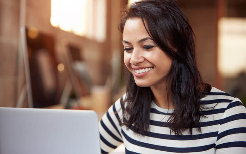 Smiling woman on laptop computer