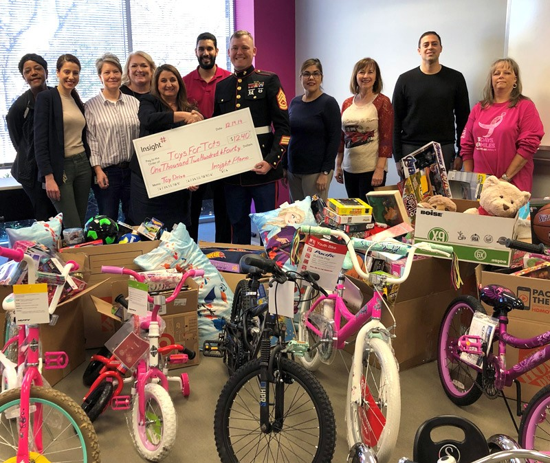 Plano teammates donate money, toys and bicycles to local Toys for Tots.