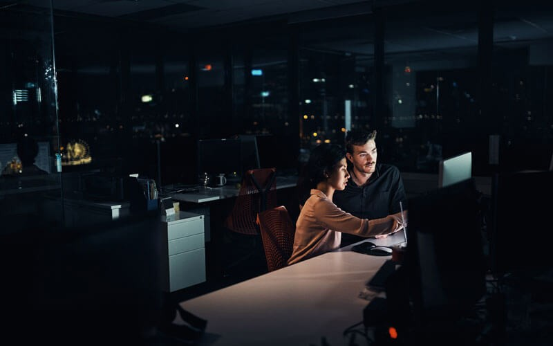 Two users working at night