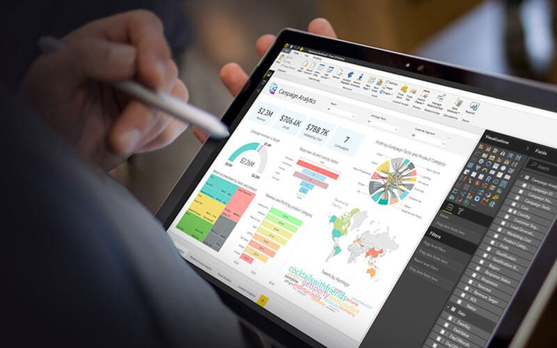 User on tablet device using Power BI application