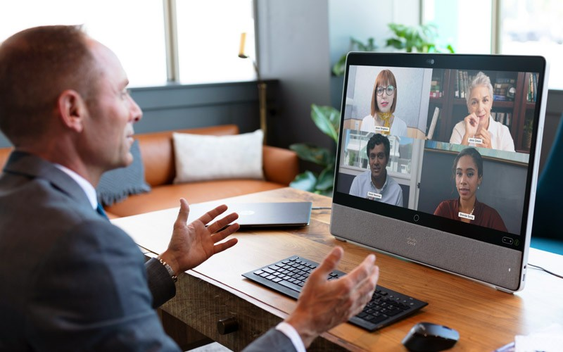 Businessman on video call using Cisco Webex on desktop computer